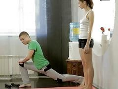 Young Teen Stretching Out With Her Instructor Help